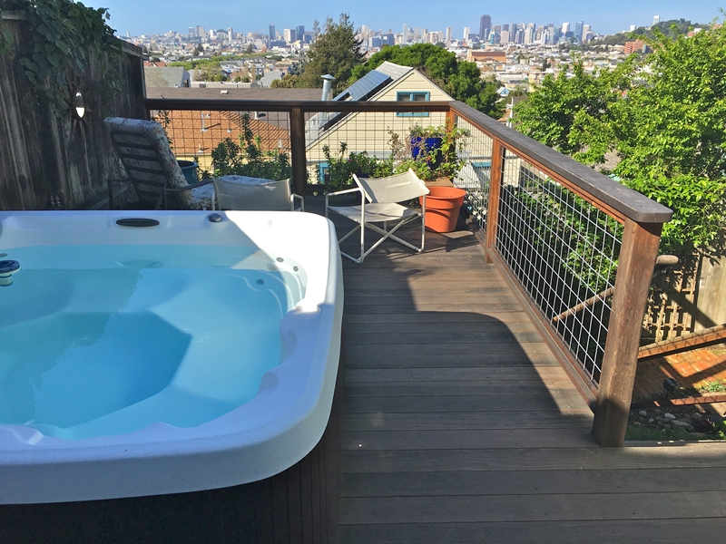 The hot tub with views of the city